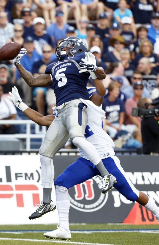 Old Dominion's Antonio Vaughan (5) drops a pass against Hampton's Lorenzo Fields in the first quarter of an NCAA college football game, Saturday, Aug. 30, 2014, in Norfolk, Va. Old Dominion won 41-28