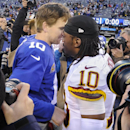 New York Giants quarterback Eli Manning (10) greets Washington Redskins quarterback Robert Griffin III (10) after the Giants beat the Washington Redskins 24-13 in an NFL football game, Sunday, Dec. 14, 2014, in East Rutherford, N.J The Associated Press