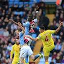 Aston Villa s Christian Benteke, centre behind, and Libor Kozak, left, go up for the same ball against Cardiff City s Steven Caulker, right, during the English Premier League match at Villa Park, Birmingham, England, Saturday, Nov. 9, 2013