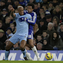 Manchester City's Vincent Kompany, left, competes for the ball with Chelsea's Loic Remy during the English Premier League soccer match between Chelsea and Manchester City at Stamford Bridge, London, England, Saturday, Jan. 31, 2015