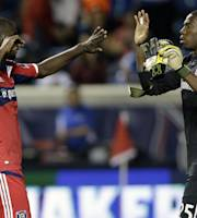 Chicago Fire goalie Sean Johnson, right, celebrates with defender Bakary Soumare after the Fire defeated the Colorado Rapids 2-1 in an MLS soccer match in Bridgeview, Ill., Wednesday, June 19, 2013. (AP Photo/Nam Y. Huh)