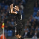 Francesco Totti captain and scorer of Roma applauds his fans during a Champions League group E soccer match between Manchester City and Roma at the Etihad Stadium, Manchester, England, Tuesday, Sept. 30, 2014. The match ended 1-1