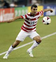 United States' Chris Wondolowski (19) receives a pass during the second half of the Gold Cup semifinals against Honduras at Cowboys Stadium, Wednesday, July 24, 2013, in Arlington, Texas. The United States won 3-1. (AP Photo/Brandon Wade)