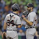 Detroit Tigers starting pitcher Justin Verlander, right, talks to catcher James McCann during the eighth inning of a baseball game against the Tampa Bay Rays Wednesday, July 29, 2015, in St. Petersburg, Fla. (AP Photo/Chris O'Meara)
