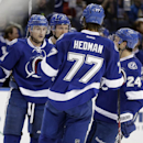 Tampa Bay Lightning center Steven Stamkos (91, left) celebrates his goal against the Washington Capitals with teammates, including, Victor Hedman (77), of Sweden, Anton Stralman (6), of Sweden, and Ryan Callahan (24) during the second period of an NHL hoc