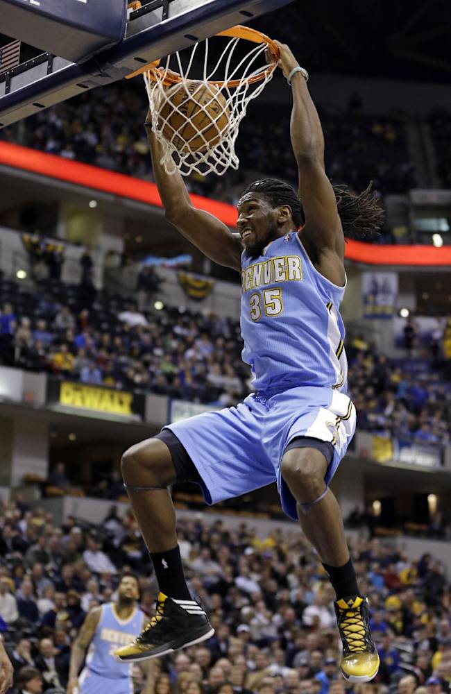 Denver Nuggets forward Kenneth Faried dunks against the Indiana Pacers in the first half of an NBA basketball game in Indianapolis, Monday, Feb. 10, 2014