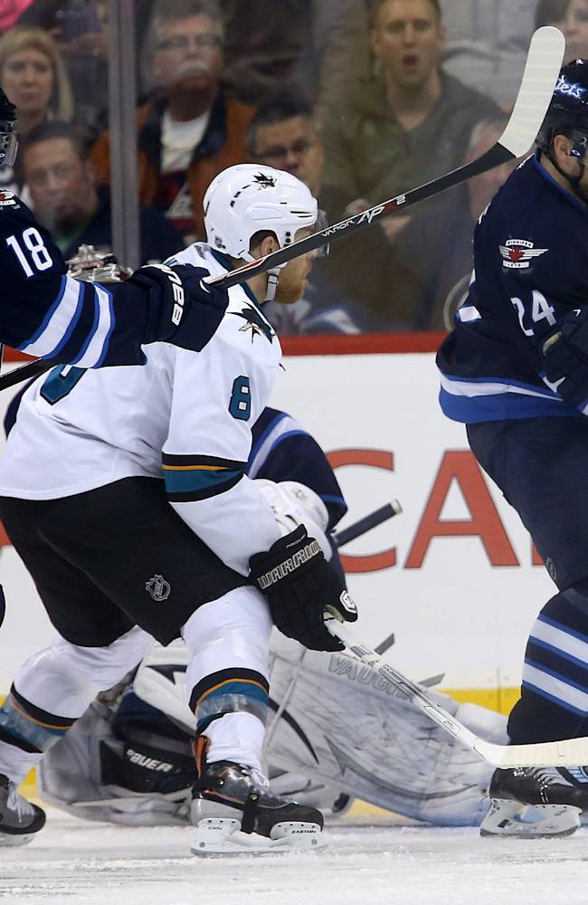 Andrew Ladd rallies Jets past Sharks 5-4 in SO