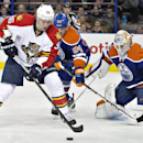 Florida Panthers Jussi Jokinen (36) picks up the rebound as Edmonton Oilers goalie Ben Scrivens (30) makes the save and Oscar Klefbom (84) defends during first-period NHL hockey game action in Edmonton, Alberta, Sunday, Jan. 11, 2015 The Associated Press