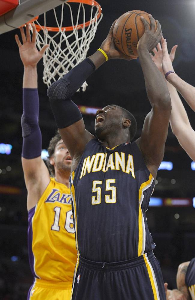 Indiana Pacers center Roy Hibbert, right, puts up a shot as Los Angeles Lakers center Pau Gasol, of Spain, defends during the first half of an NBA basketball game, Tuesday, Jan. 28, 2014, in Los Angeles