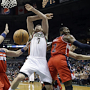 Milwaukee Bucks' Ersan Ilyasova (7) battles for a rebound with Washington Wizards' John Wall (2) and Marcin Gortat (4) during the second half of an NBA basketball game Wednesday, Nov. 27, 2013, in Milwaukee The Associated Press