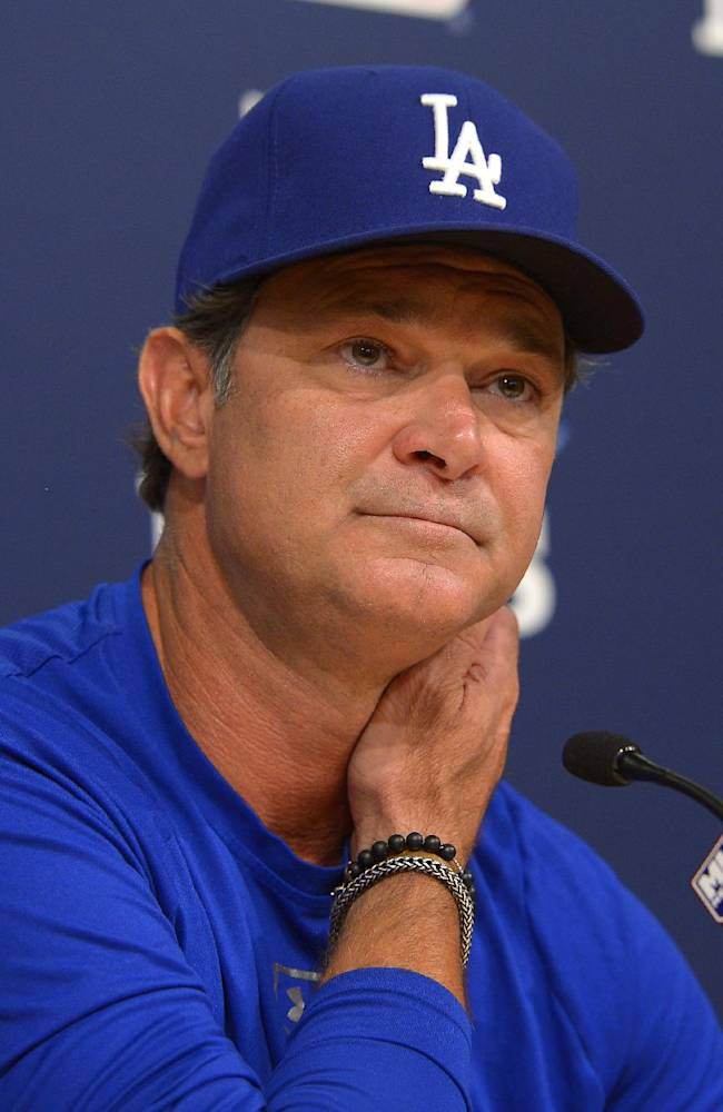 Los Angeles Dodgers manager Don Mattingly listens to a question during a news conference for Game 3 of the National League baseball division series against the Atlanta Braves, Saturday, Oct. 5, 2013, in Los Angeles
