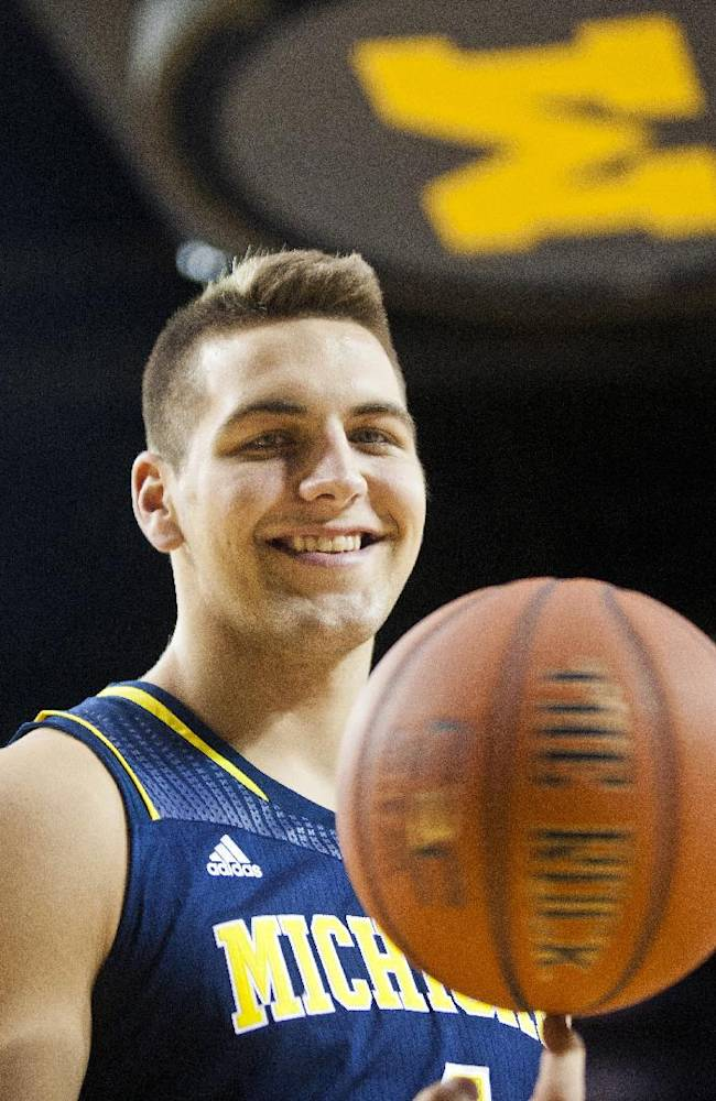 Michigan forward Mitch McGary poses for a portrait during an NCAA college basketball team's preseason media day Thursday, Oct. 24, 2013, at the Crisler Center in Ann Arbor, Mich