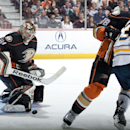 Ducks' goaltender Frederik Andersen makes a kick save behind teammate Mark Fistric and Buffalo's Tyler Ennis during the second period at Honda Center Wednesday night Oct. 22, 2014 The Associated Press