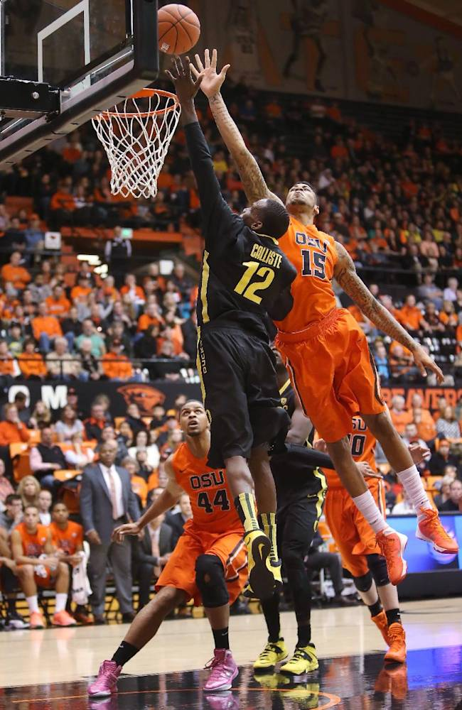 Oregon State's Eric Moreland blocks a shot by Oregon's Jason Calliste during an NCAA men's basketball game at Gill Coliseum in Corvallis, Ore. on Sunday, Jan. 19, 2014. Oregon lost 80-72 to Oregon State