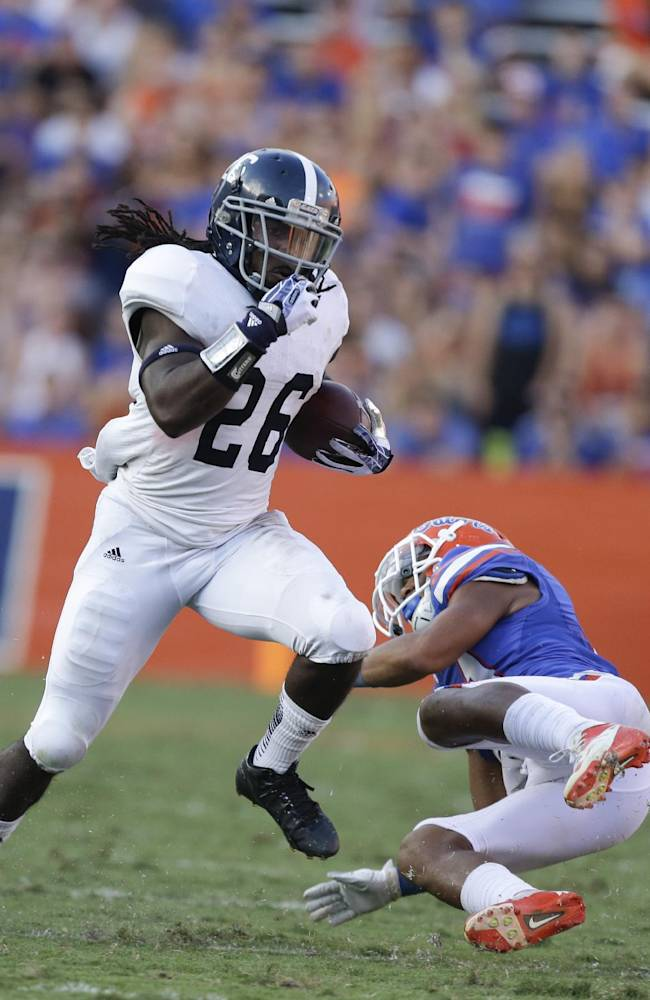 Georgia Southern wide receiver Tray Butler (26) runs past Florida defensive back Cody Riggs during the second half of an NCAA college football game in Gainesville, Fla., Saturday, Nov. 23, 2013