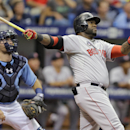 Boston Red Sox's David Ortiz watches his three-run home run off Tampa Bay Rays starting pitcher Chris Archer during the third inning of a baseball game Sunday, July 27, 2014, in St. Petersburg, Fla. Red Sox's Daniel Nava and Dustin Pedroia also scored. Catching for the Rays is Curt Casali. (AP Photo/Chris O'Meara)