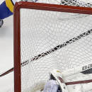Minnesota Wild goalie Devan Dubnyk loses his helmet as he gets knocked back into the goal during the third period in Game 5 of an NHL hockey first-round playoff series against the St. Louis Blues, Friday, April 24, 2015, in St. Louis. The Wild won 4-1. (AP Photo/Jeff Roberson)