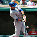 Texas Rangers' Alex Rios hits an RBI single in the first inning of a baseball game against the Cleveland Indians Sunday, Aug. 3, 2014, in Cleveland. (AP Photo/Aaron Josefczyk)