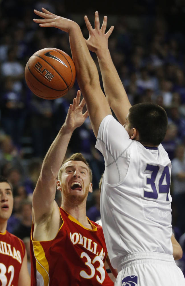 Kansas State forward Jack Karapetyan (34) blocks a shot by Pittsburg State Connor Kier (33) during the first half of an exhibition NCAA college basketball game in Manhattan, Kan., Friday, Nov. 1, 2013. Kansas State defeated Pittsburg State 75-54