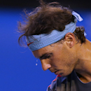 Beads of the sweat drop off the forehand of Spain's Rafael Nadal as he serves to Stanislas Wawrinka of Switzerland during the men's singles final at the Australian Open tennis championship in Melbourne, Australia, Sunday, Jan. 26, 2014.(AP Photo/Aaron Favila)