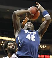 Pittsburgh's Talib Zanna (42) shoots in front of Duquesne's Dominique McKoy (3) in the first half of an NCAA college basketball game on Saturday, Nov. 30, 2013, in Pittsburgh. (AP Photo/Keith Srakocic)