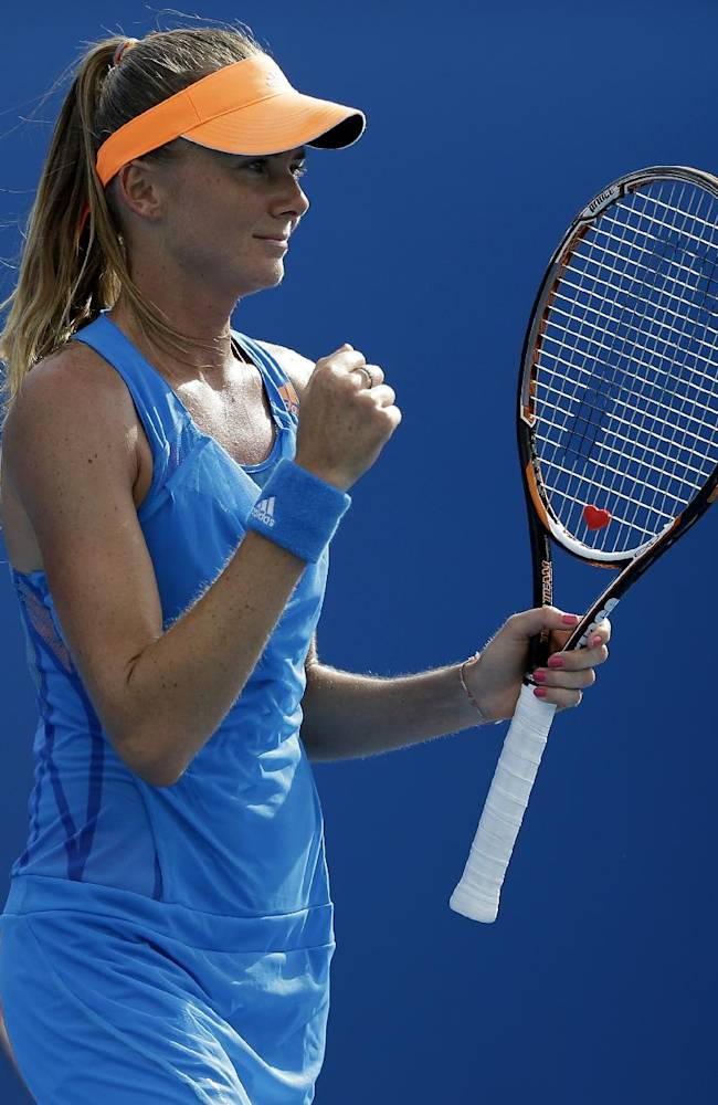 Daniela Hantuchova of Slovakia celebrates after defeating Karolina Pliskova of the Czech Republic in their second round match at the Australian Open tennis championship in Melbourne, Australia, Wednesday, Jan. 15, 2014