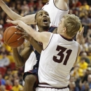 Arizona guard Mark Lyons, left, collides with Arizona State's Jonathan Gilling (31) as he drives to the basket during the first half of an NCAA basketball game, Saturday, Jan. 19, 2013, in Tempe, Ariz. (AP Photo/Ralph Freso)