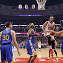 Chicago Bulls center Joakim Noah (13) is stripped of the ball by Golden State Warriors center Andrew Bogut, right, as Stephen Curry (30) and Jermaine O'Neal (7) also defend during the first half of an NBA basketball game, Wednesday, Feb. 26, 2014, in Chic