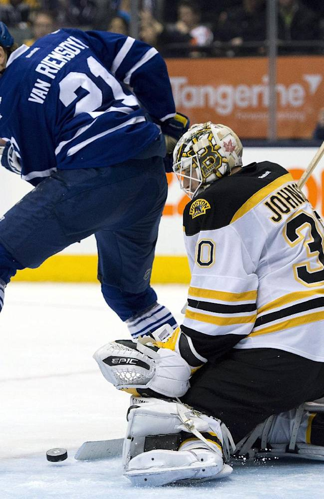 Toronto Maple Leafs left winger James van Riemsdyk screens a shot on Boston Bruins goaltender Chad Johnson during the second period of an NHL hockey game in Toronto on Thursday, April 3, 2014