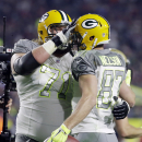 Green Bay Packers' Jordy Nelson, left, is congratulated by Green Bay Packers' Josh Sitton after scoring a touchdown during the first half of the NFL Football Pro Bowl Sunday, Jan. 25, 2015, in Glendale, Ariz The Associated Press