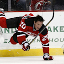 New Jersey Devils center Ryan Carter loses his helmet after colliding with Washington Capitals defenseman John Carlson during the first period of an NHL hockey game, Friday, April 4, 2014, in Newark, N.J The Associated Press