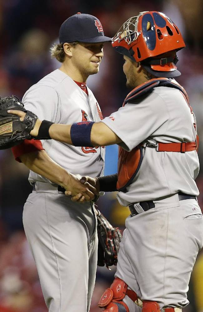 St. Louis Cardinals relief pitcher Trevor Rosenthal, left, is congratulated by catcher Yadier Molina after they defeated the Cincinnati Reds 7-6 in a baseball game on Thursday, April 3, 2014, in Cincinnati. Rosenthal recorded his second save of the season