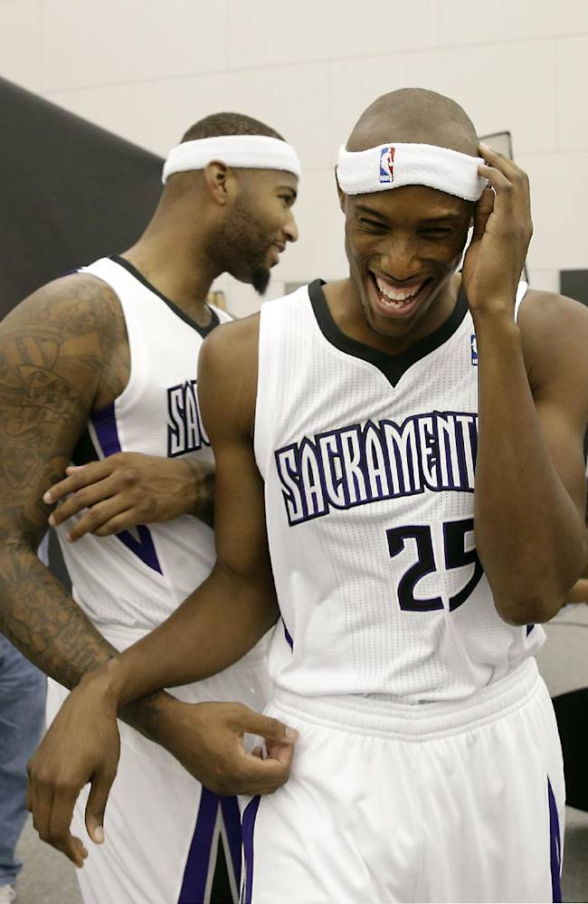 Sacramento Kings center DeMarcus Cousins, left, jokes with teammate Travis Outlaw during the team's NBA basketball media day in Sacramento, Calif., Monday, Sept. 30, 2013