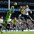 Tottenham Hotspur s Michael Dawson, right, jumps for the ball with Newcastle United s Michael Williamson and Tim Krul, left, during their English Premier League soccer match at the White Hart Lane stadium in London, Sunday Nov. 10, 2013