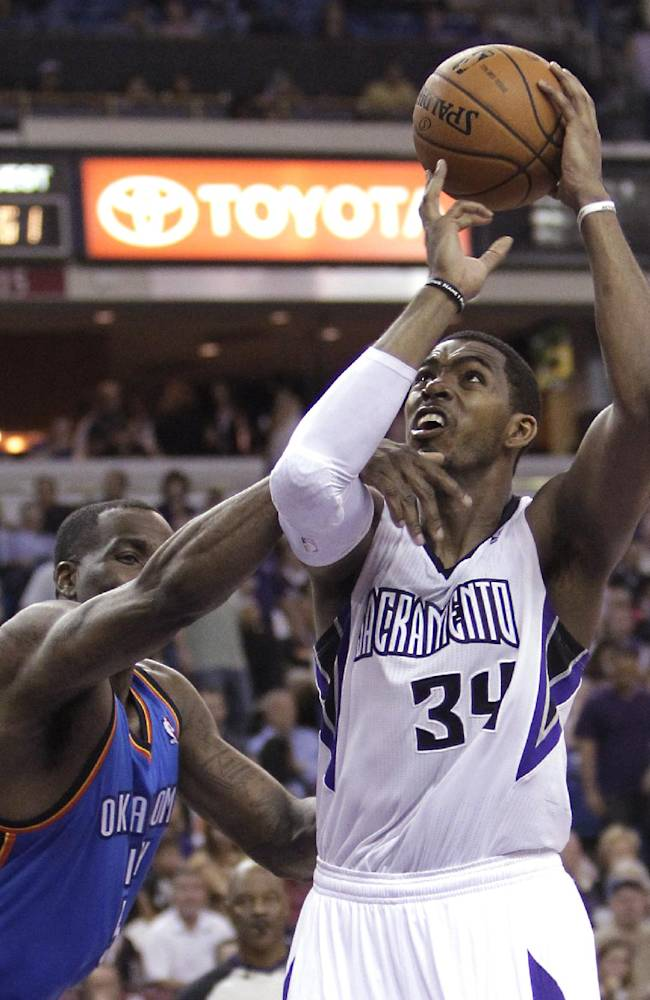 Sacramento Kings forward Jason Thompson, right, is fouled by Oklahoma City Thunder center Kendrick Perkins during the third quarter of an NBA basketball game, Tuesday, April 8, 2014, in Sacramento, Calif. The Thunder won 107-92