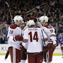Phoenix Coyotes' Jeff Halpern (14) celebrates with teammates after scoring during the first period of the NHL hockey game against the New York Rangers, Monday, March 24, 2014, in New York The Associated Press