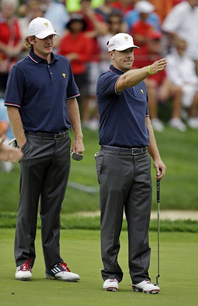 United States team player Hunter Mahan, right, discusses a putt with teammate Brandt Snedeker on the first green during a four-ball match against the International team at the Presidents Cup golf tournament at Muirfield Village Golf Club Thursday, Oct. 3, 2013, in Dublin, Ohio
