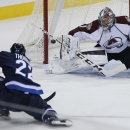 Winnipeg Jets' Chris Thorburn (22) scores his first goal of the season against Colorado Avalanche goaltender Semyon Varlamov (1) during first-period NHL hockey game action in Winnipeg, Manitoba, Friday, Dec. 5, 2014 The Associated Press