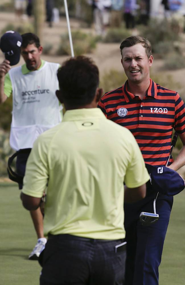 Webb Simpson, right, shakes hands after winning on the 16th hole in his match against Thongchai Jaidee during the first round of the Match Play Championship golf tournament on Wednesday, Feb. 19, 2014, in Marana, Ariz. Simpson won 3 and 2