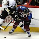 Pittsburgh Penguins center Brandon Sutter, left, becomes entangled with Colorado Avalanche left wing as he tries to control the puck in the first period of an NHL hockey game Wednesday, March 4, 2015, in Denver. (AP Photo/David Zalubowski)