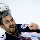 Columbus Blue Jackets' Nick Foligno loses his helmet during a fight with Vancouver Canucks' Tom Sestito during third period NHL hockey action in Vancouver, British Columbia, Friday, Nov. 22, 2013 The Associated Press