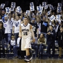 Fans hold up 3-point signs after Butler guard Rotnei Clarke (15) made a 3-point shot during the first half of an NCAA college basketball game against Temple on Saturday, Jan. 26, 2013, in Indianapolis. (AP Photo/Darron Cummings)