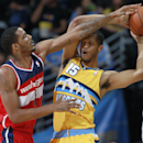 Washington Wizards forward Trevor Ariza, left, reaches for ball as Denver Nuggets forward Anthony Randolph looks to pass in the first quarter of an NBA basketball game, Sunday, March 23, 2014, in Denver The Associated Press
