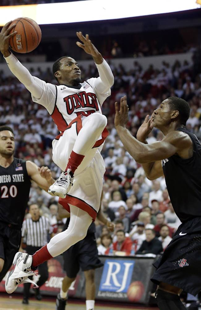 UNLV's Deville Smith shoots over San Diego State's Skylar Spencer during the second half of an NCAA college basketball game on Wednesday, March 5, 2014, in Las Vegas. San Diego State defeated UNLV 73-64