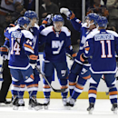 New York Islanders center Anders Lee (27), center, is congratulated by teammates after scoring against the Washington Capitals the first period of an NHL hockey game at Nassau Coliseum on Wednesday, Nov. 26, 2014, in Uniondale, N.Y The Associated Press