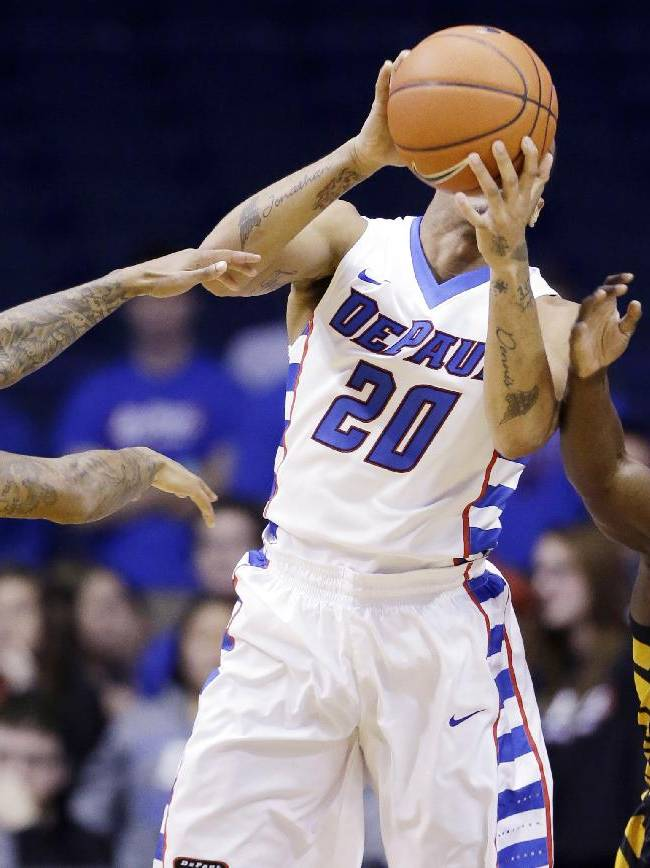 DePaul guard Brandon Young (20) tries to pass as Southern Mississippi guard Neil Watson, left, and guard Jerrold Brooks guard during the first half of an NCAA college basketball game in Rosemont, Ill., Wednesday, Nov. 13, 2013