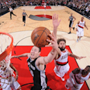 PORTLAND, OR - DECEMBER 15: Aron Baynes #16 of the San Antonio Spurs goes to the basket against Robin Lopez #42 of the Portland Trail Blazers on December 15, 2014 at the Moda Center in Portland, Oregon. (Photo by Sam Forencich/NBAE via Getty Images)