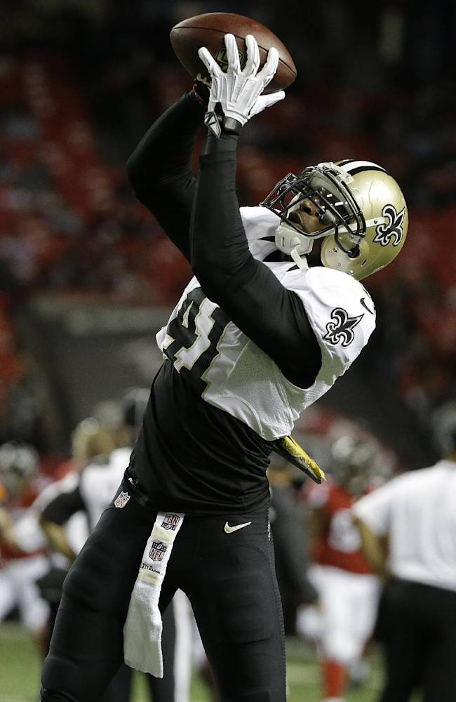 New Orleans Saints strong safety Roman Harper (41) works before the first half of an NFL football game against the Atlanta Falcons, Thursday, Nov. 21, 2013, in Atlanta