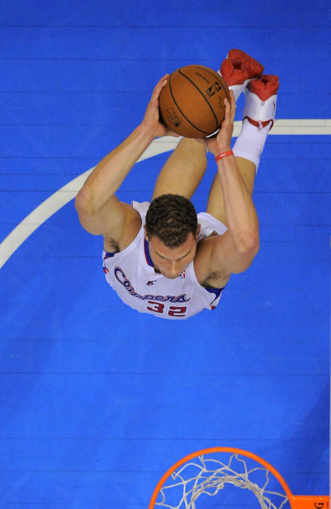 James, Heat hold off Clippers 116-112