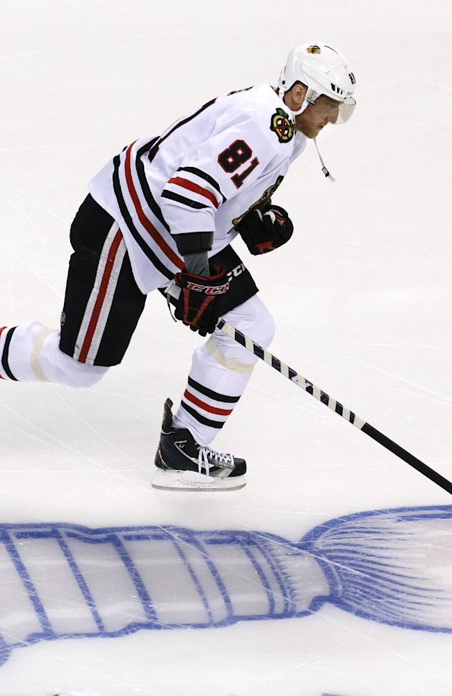 Chicago Blackhawks right wing Marian Hossa (81), of Slovakia, skates during warm-ups before Game 4 of the NHL hockey Stanley Cup Finals between the Boston Bruins and the Blackhawks, Wednesday, June 19, 2013, in Boston